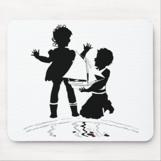 silhouette of girl and boy and model boat mouse pad