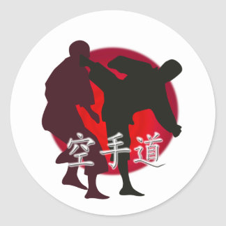 Silhouette of Karate fight, red circle background. Round Stickers