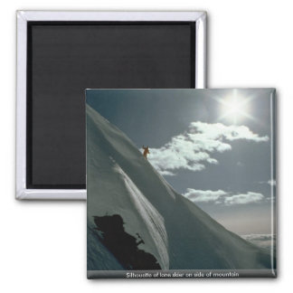 Silhouette of lone skier on side of mountain fridge magnets