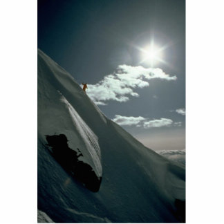 Silhouette of lone skier on side of mountain photo cutout