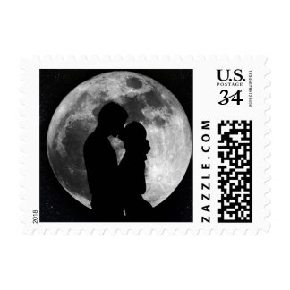 Silhouette of lovers in a full moon at night stamp