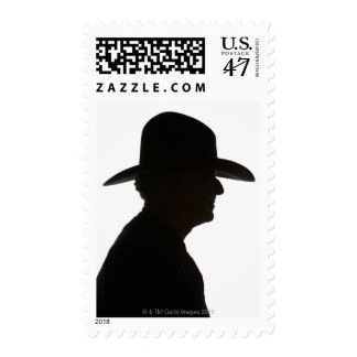 Silhouette of man in profile wearing traditional postage