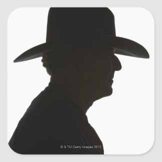 Silhouette of man in profile wearing traditional square sticker