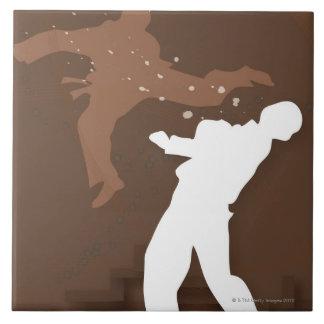 Silhouette of two men practicing karate ceramic tile
