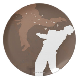 Silhouette of two men practicing karate dinner plate