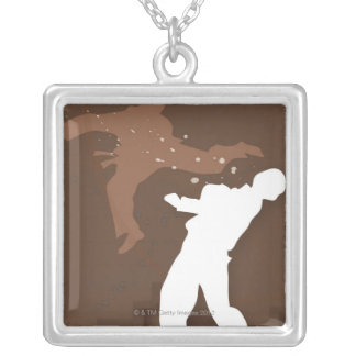 Silhouette of two men practicing karate silver plated necklace