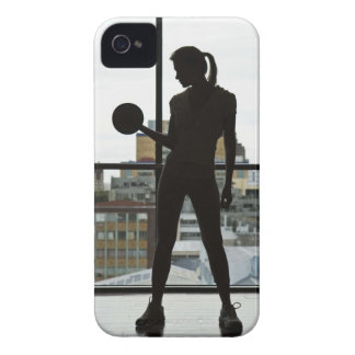 Silhouette of woman lifting weights at gym iPhone 4 cover