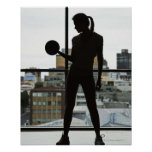 Silhouette of woman lifting weights at gym print