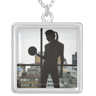 Silhouette of woman lifting weights at gym silver plated necklace