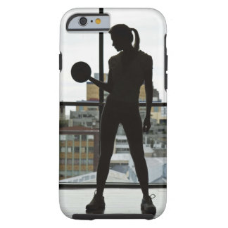 Silhouette of woman lifting weights at gym tough iPhone 6 case