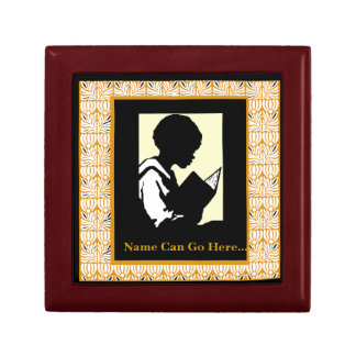 Silhouette of Young Boy Reading Storage Box