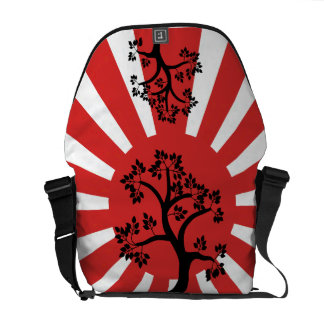 Silhouette tree on rising sun background courier bag
