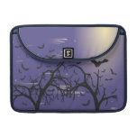 Silhouette trees and bats sleeves for MacBooks