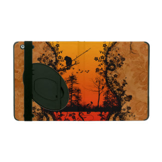 Silhouette, trees and birds on red,golden backgrou iPad case