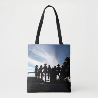Silhouette western cowboys and cowgirls on fence tote bag