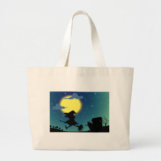 Silhouette witch flying on broom at night jumbo tote bag