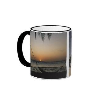 Silhouetted empty hammock at sunset ringer mug