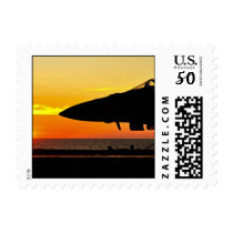 Silhouetted Jet at Sunrise aboard US Navy Carrier Postage