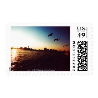 Silhouetted Tokyo Bay skyline at sunset Postage Stamp