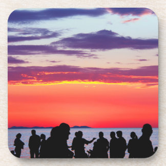Silhouettes in the sunset beverage coaster
