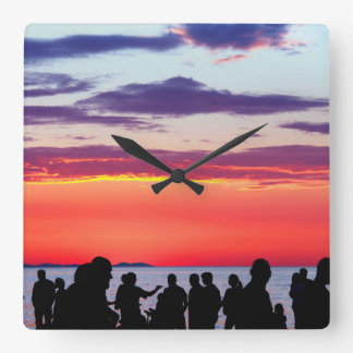 Silhouettes in the sunset square wall clock