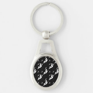 Silhouettes of Hundreds of White Witches Silver-Colored Oval Metal Keychain