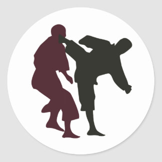 Silhouettes of Martial Artists During a Fight Classic Round Sticker