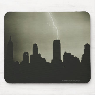 Silhouettes of skyscrapers and lightning in sky mouse pad