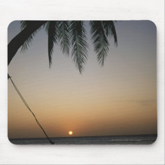 Silhuetted empty hammock at sunset mouse pad