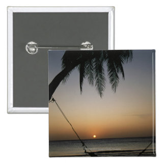 Silhuetted empty hammock at sunset pinback button