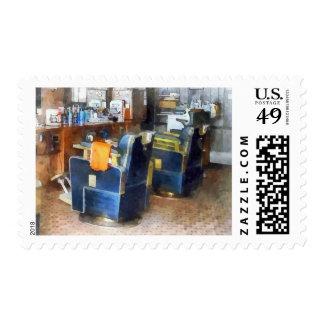 Silla de peluquero con el cabo anaranjado del timbre postal
