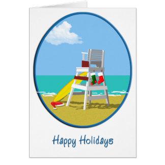 Silla del salvavidas en el navidad tarjeta de felicitación