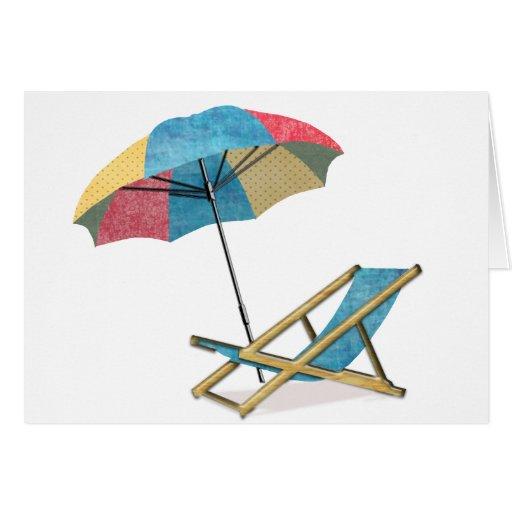 Silla y paraguas de playa tarjeta de felicitación