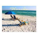 Sillas de playa azules en la Florida Postales