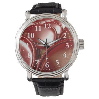 Sillas plegables rojas reloj de mano