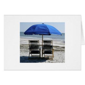 Sillas y paraguas de playa tarjeta pequeña