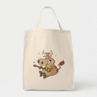 silly cow cartoon playing guitar tote bags