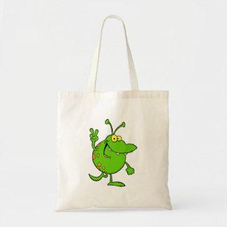 silly cute cartoon peace gesture alien dude tote bag