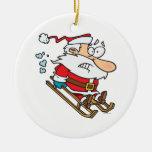 silly scared santa on a sled cartoon ornament