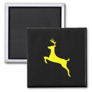 Silueta amarilla de los ciervos imanes para frigoríficos