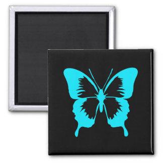 Silueta de la mariposa del azul de cielo que agita imán para frigorifico