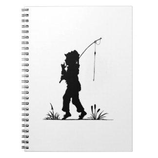 Silueta de la pesca de la niña cuaderno