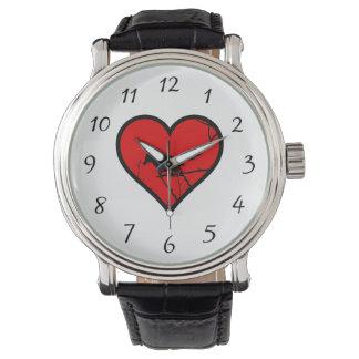 Silueta de los pájaros del amor del corazón del reloj