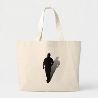 Silueta de un hombre bolsa lienzo
