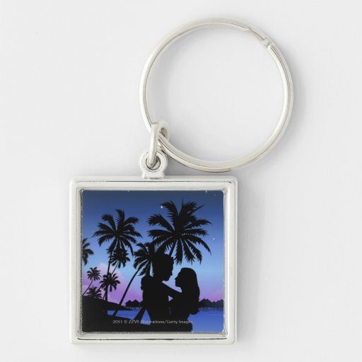 Silueta de un par que abraza en la playa llavero cuadrado plateado