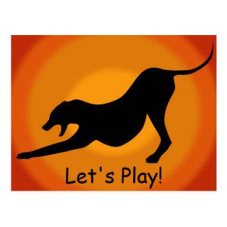 Silueta de un perro estirado en fondo anaranjado tarjetas postales