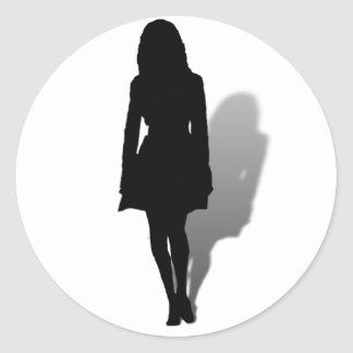 Silueta de una mujer pegatina redonda