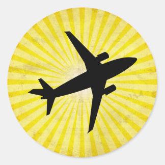 Silueta del aeroplano; amarillo pegatina redonda