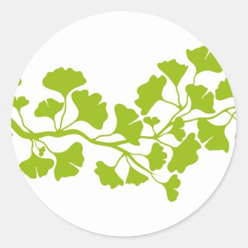 silueta del árbol del ginkgo con las hojas verdes etiquetas redondas