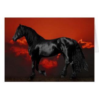 Silueta del caballo en la puesta del sol felicitaciones
